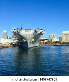 San Diego, CA, USA - October 2 2018 : Aircraft carrier USS Midway from the front. Huge war ship parked at the San Diego bay. Museum warship.