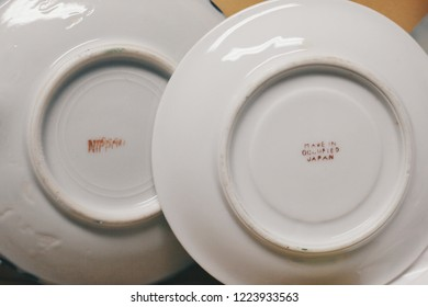 San Diego, CA / USA - September 17 2017: Saucers featuring marks indicating they were made in US Occupied Japan after WW2.