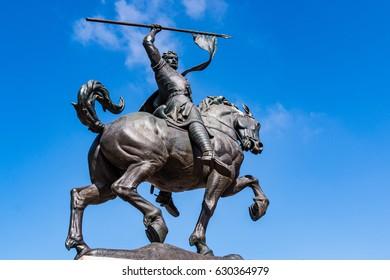 "SAN DIEGO, CALIFORNIA - APRIL 28, 2017:  Bronze statue ""El Cid Campeador,"" installed in Plaza de Panama in Balboa Park, created in 1927 by Anna Hyatt Huntington and William Templeton Johnson."