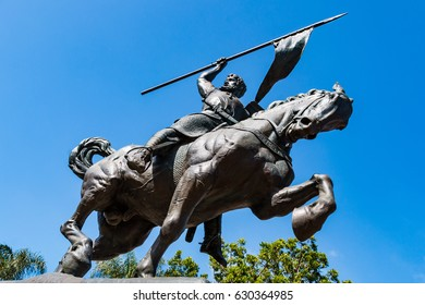 """SAN DIEGO, CALIFORNIA - APRIL 28, 2017:  Bronze statue """"El Cid Campeador,"""" created in 1927 by sculptor Anna Hyatt Huntington and architect William Templeton Johnson, and located in Balboa Park."""