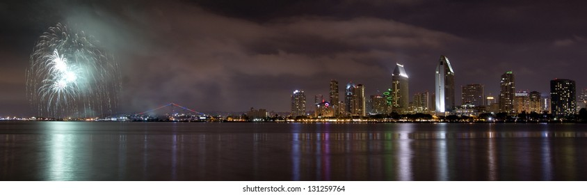 San Diego California City Skyline at Night and Fireworks Celebration Observed from Coronado Island