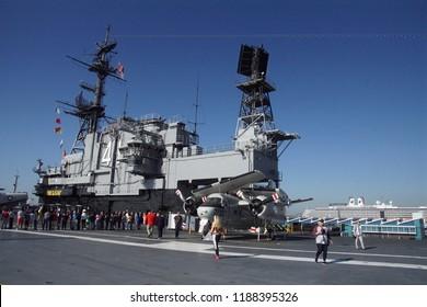 SAN DIEGO, CALIFORNIA - DEC 1, 2017 - C-1 Cargo transport plane on the flight deck of the USS Midway CV-41 Aircraft Carrier, San Diego, California