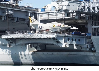 SAN DIEGO, CALIFORNIA - DEC 1, 2017 - US Navy jet fighter on hangar deck elevator ofUSS Midway CV-41 Aircraft Carrier, San Diego, California