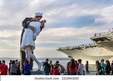 San Diego, California – December 3, 2017: Unconditional Surrender Sculpture with the background of Uss Midway navy ship museum, San Diego Bay.