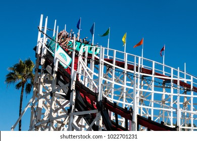SAN DIEGO, CALIFORNIA - FEBRUARY 9, 2018:  People ride the Giant Dipper roller coaster, built in 1925, and located at Belmont Park on the Mission Beach boardwalk.