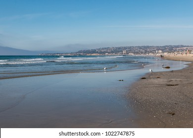 SAN DIEGO, CALIFORNIA - FEBRUARY 9, 2018:  Low tide at Mission Beach, a beach of just over one mile in length and one of the most popular beaches in the area.  It is adjacent to Belmont Park.
