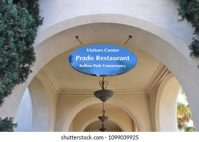 San Diego, California - January 14, 2018: Signs of Visitor Center, Prado Restaurant and Balboa Park Conservancy hanging in front of the hall of House of Hospitality.