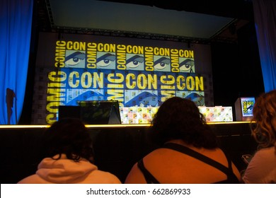 SAN DIEGO, CALIFORNIA - JULY 24 2014: Fans in the front row wait for their favorite celebrities to appear on stage in Ballroom 20, the second largest programming venue at San Diego Comic-Con.