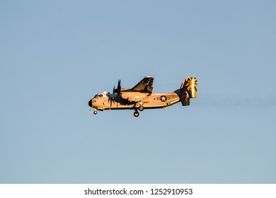 SAN DIEGO, CALIFORNIA - MARCH 2, 2017:  A Grumman, C-2A Greyhound U.S. Navy, twin-engine, high-wing cargo plane flies toward Naval Air Station North Island.