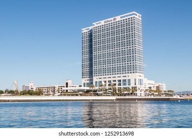 SAN DIEGO, CALIFORNIA - MARCH 2, 2017:  The Hilton Hotel along San Diego Bay with the Harbor Drive pedestrian bridge in the background.