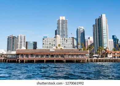 SAN DIEGO, CALIFORNIA - MARCH 2, 2017:   Hotels, restaurants and apartment buildings line the waterfront along San Diego Bay.