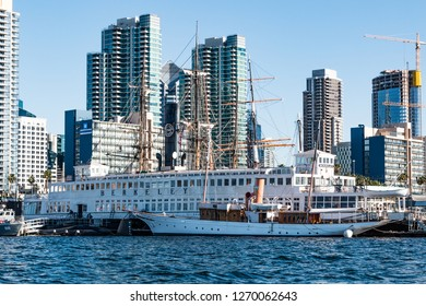 SAN DIEGO, CALIFORNIA - MARCH 2, 2017:  A collection of historic vessels at the Maritime Museum of San Diego, including the Steam Ferry Berkeley, with the downtown skyline in the background.