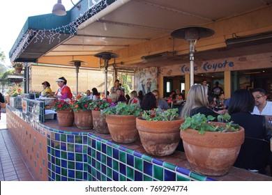 SAN DIEGO, CALIFORNIA - NOV 26, 2017 - Women making fresh tortillas in a Mexican restaurant, Old Town, San Diego, California