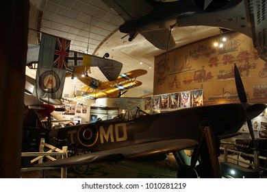SAN DIEGO, CALIFORNIA - NOV 27, 2017 - British Spitfire fighter plane with yellow Stearman N25 in backgroundAir and Space Museum at Balboa Park in San Diego, California