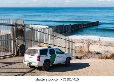 SAN DIEGO, CALIFORNIA - NOVEMBER 4, 2017:  A Border Patrol vehicle patrols near the border wall ending in the Pacific ocean at the international border separating San Diego from Tijuana, Mexico.