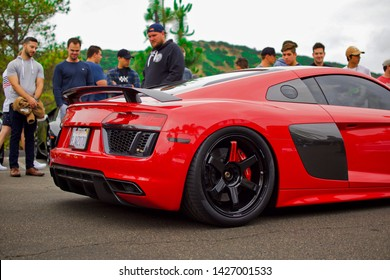 San Diego, California / United States - June 14 2019: Slammed red Audi r8 parked in a crowd