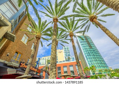 San Diego, California, United States - July 31, 2018: bottom view of entrance sign to Gaslamp Quarter, a Historic Victorian District of San Diego Downtown. Urban street city with palm trees.