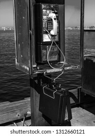 SAN DIEGO, CALIFORNIA, US - MARCH 11, 2007: Old public pay phone booth in San Diego California, US on March 11, 2007.