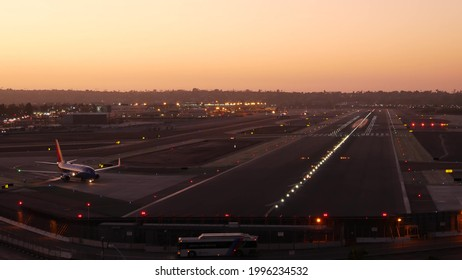 San Diego, California USA - 24 Nov 2020: Southwest Airlines plane on international airport runway, airplane on Lindbergh Field airstrip. Aircraft on aerodrome or airfield. Passenger airliner at sunset