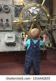 San Diego, California, USA - 4/2015: USS Midway Museum child at steering controls
