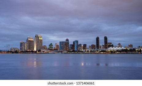 SAN DIEGO, CALIFORNIA, USA – APRIL 15, 2019: The skyline of San Diego as seen from Coronado on a cloudy evening – San Diego, CA