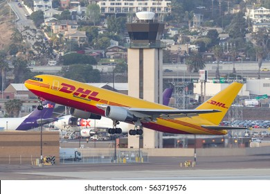 San Diego, California, USA - April 30, 2013. DHL Boeing 767 Cargo aircraft  departing San Diego International Airport.