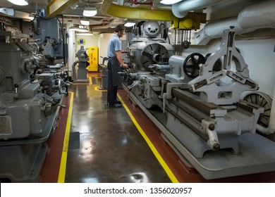 San Diego, California, USA – August 1, 2017: Horizontal shot of a fake sailor working with machinery in the USS Midway aircraft carrier, Navy Pier