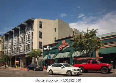 San Diego, California, USA – August 1, 2017: Horizontal view of the 6th Ave with the green Bucca di Beppo Italian restaurant façade, Gaslamp Quarter