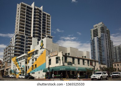 San Diego, California, USA – August 1, 2017: Horizontal view of the 6th Ave with Island Ave crossing with the charming colorful Hotel Z façade surrounded by huge skyscrapers, Gaslamp Quarter