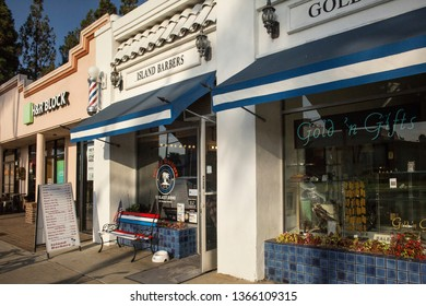 San Diego, California, USA – August 1, 2017: Horizontal shot of the Island Barbers barber shop façade between two other stores in Orange Ave, Coronado Island