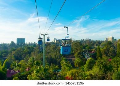 San Diego, California, USA - December 22, 2018: People are riding on cable car over San Diego zoo.