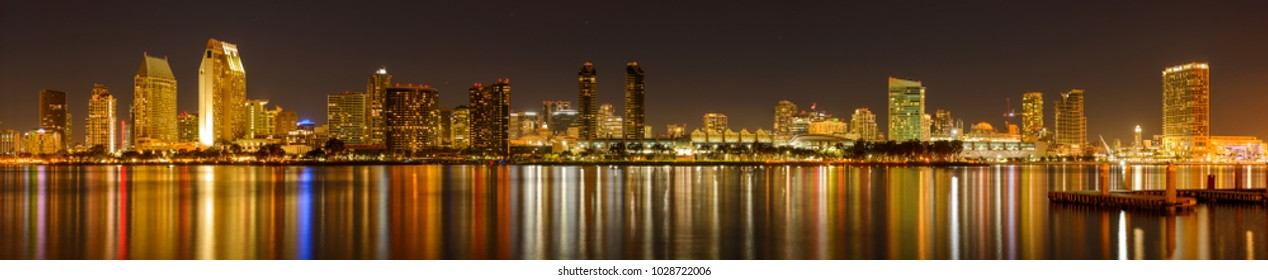 San Diego, California, USA - January 28, 2018: A panoramic night view of waterfront skyline of San Diego Downtown at San Diego Bay, looking from Coronado Peninsula.