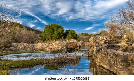 San Diego, California / USA - January 24, 2016: Mission Trails Regional Park. Recent rainfall in the region gives a healthy flow of water over the spillway of the historical Old Mission Dam.