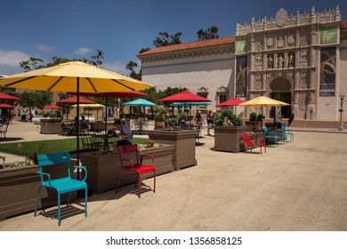 San Diego, California, USA – July 28, 2017: Horizontal view of the plateresque San Diego Museum of Art façade at Plaza de Panama, beautifully decorated with colorful umbrellas and chairs, Balboa Park