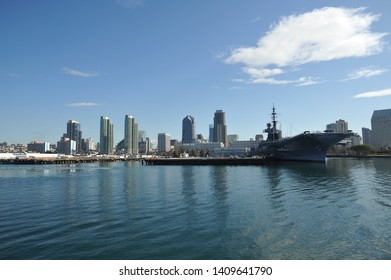 "SAN DIEGO, CALIFORNIA / USA - NOVEMBER 29 2009: View of the San Diego skyline and aircraft carrier Midway from the San Diego - Coronado ferry boat ""Cabrillo""."