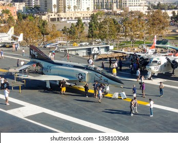 SAN DIEGO, CALIFORNIA / USA - October 19, 2013: A group of tourists are exploring the midway aircraft carrier