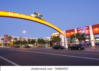 SAN DIEGO, CALIFORNIA, USA - OCTOBER 4, 2017: A wide arching sign over Cesar Chavez Parkway welcomes visitors to the predominantly Latino community of Barrio Logan in San Diego.