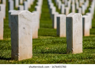 San Diego, California / USA - September 15 2019: Close up of tombstones in Fort Rosecrans National Cemetery, a federal military cemetery, on a sunny day.