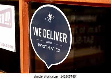 San Diego, California/United States - 05/31/2019: A door sticker advertising delivery service available by Postmates