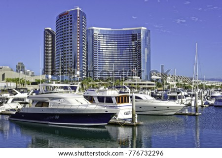 SAN DIEGO, CLAIFORNIA USA - NOVEMBER 5, 2017: Luxury yachts in Embarcadero Marina near Seaport Village in San Diego Bay with the San Diego skyline and the Marriott Marquis Hotel in the background.
