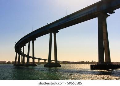 "San Diego - Coronado Bridge, locally referred to as the Coronado Bridge, is a concrete & steel"" bridge, crossing over San Diego Bay in the United States, linking San Diego, with Coronado, California."