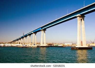 The San Diego Coronado bridge over the city skyline and water.
