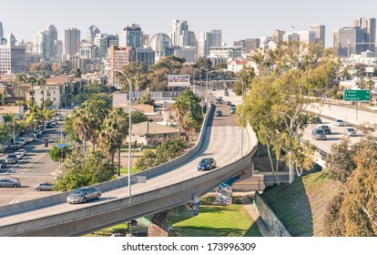 SAN DIEGO - DECEMBER 20, 2013: highway leading to San Diego downtown viewed from Coronado Bridge. The value of tourism to the city helped the development of roads, since 70% of tourists arrive by car.
