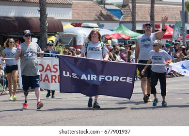 SAN DIEGO - JULY 15: Unidentified men and women march in San Diego's LGBT Pride Parade representing the U.S. Navy on July 15, 2017.