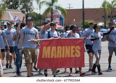 SAN DIEGO - JULY 15: Unidentified men and women march in San Diego's LGBT Pride Parade representing the U.S. Marine Corps on July 15, 2017.
