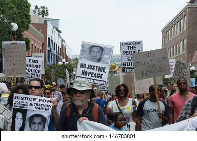 SAN DIEGO - JULY 20: Protesters carried placards in support Trayvon and other victims of violence. July 20, 2013, during Comic Con in downtown San Diego, CA.