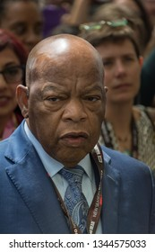 """San Diego - July 22, 2017: Representative John Lewis leading a march after a panel about the graphic novel trilogy """"March"""" at San Diego Comic-Con 2017."""