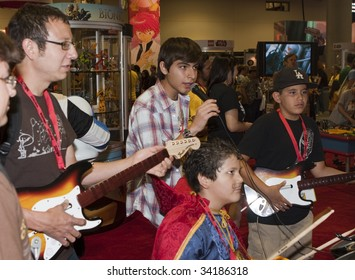 SAN DIEGO - JULY 23: Fans at Comic-Con 2009, try out the future release of Lego Rock Band - Day 1 on July 23, 2009 in San Diego, CA