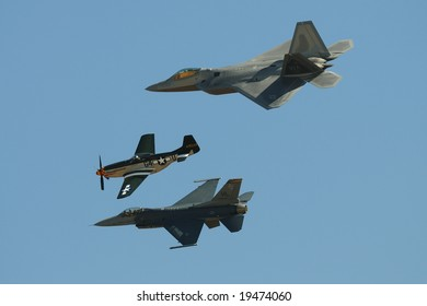 SAN DIEGO - OCT 5: F-22 Raptor, P51, and F-16 Fighting Falcon performing Heritage Flight at the 2008 MCAS Miramar Air Show.