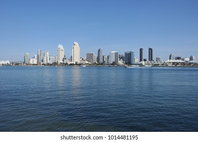 San Diego Skyline at noon from Coronado Island. San Diego at noon with Coronado Bay in Foreground and speeding boat.
